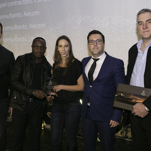 Claire D'Adorante and Thulani Sibande accept the Award for Innovative Developments